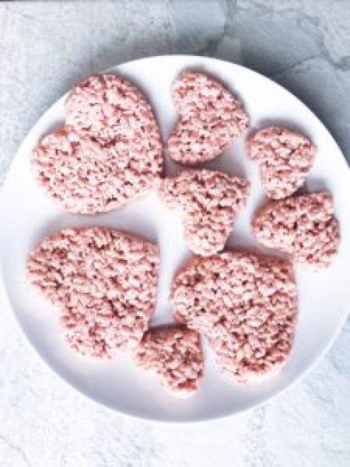 pink heart shaped Rice Krispie Treats on a white plate