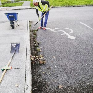 Bettystown tidy Towns cleaning kerbs