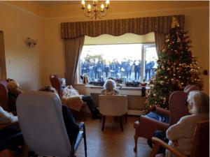 Residents at St Ursula's Watch CNI Dáltaí Sing Christmas Carols
