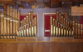 Fitting of rear pipework in 87 key Gavioli organ.
