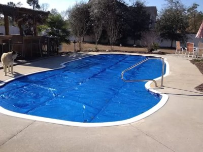 cheap ways to heat your pool solar pool cover solar cover pool reduce heat loss heat inground pool