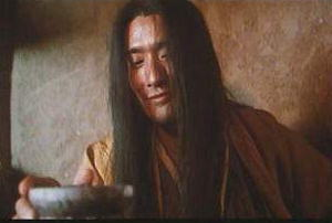 Tony Leung Kar Fai drinks the magic wine in Ashes of Time