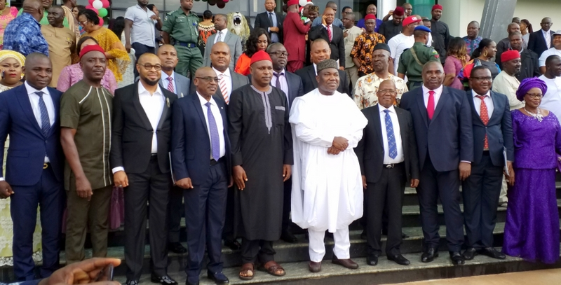 Governor Ifeanyi Ugwuanyi of Enugu State (in white) with the new Commissioners after they were sworn in at the EXCO Chambers, Government House, Enugu.