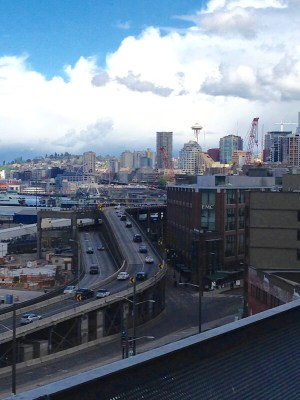 From the top of Century Link Field, looking out into the SoDo/Duwamish industrial neighborhoods. The Alaskan Way Viaduct Highway – built to enable easy on/off access to the stadiums for those coming in from the suburbs – can also be seen, with downtown Seattle and the iconic Space Needle in the far background. Photo: Helen Morgan Parmett
