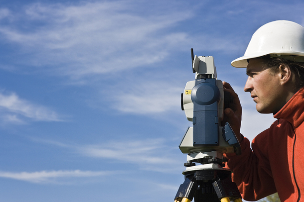 Land surveyor working on a project.
