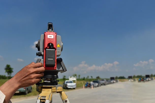 Survey equipment on a road.