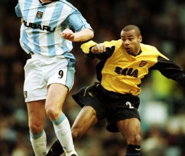 Coventry Citys Cedric Roussel And Arsenals Ashley Cole Jump For