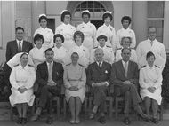 Front row Right to left Sr A de Bod, Dr. Garisch, Dr. A Blyth, Matron D.M.S.M Wagener, Dr. Uys. Second Row Right Mr Vince Louw Hospital Handy man and Radiographer, Left Mr. Olivier Hospital Secretary.