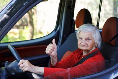 201611-elderly-woman-driving-thumbs-up