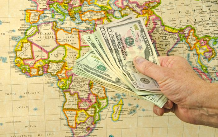 map of Africa and handful of dollars