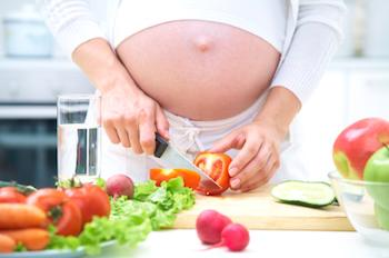 Pregnant lady preparing a salad