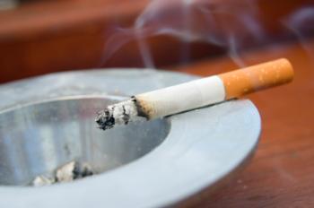 burning cigarette on ashtray