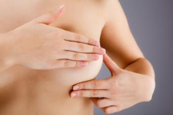 A woman checking her breast