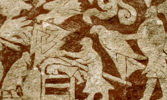 A section from the Stora Hammars I stone from Gotland, Sweden. The illustration shows a man lying on his belly with another man using a weapon on his back. There is a Valknut above him, and two eagles, one of which is held by a man to the right.