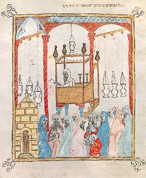 Image of a cantor reading the Passover story in Moorish Spain, from a 14th century Spanish Haggadah