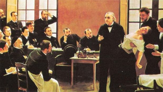 "Professor Jean-Martin Charcot teaching at the Salpêtrière in Paris, France: showing his students a woman (""Blanche"" (Marie) Wittman) in an trance or shock."
