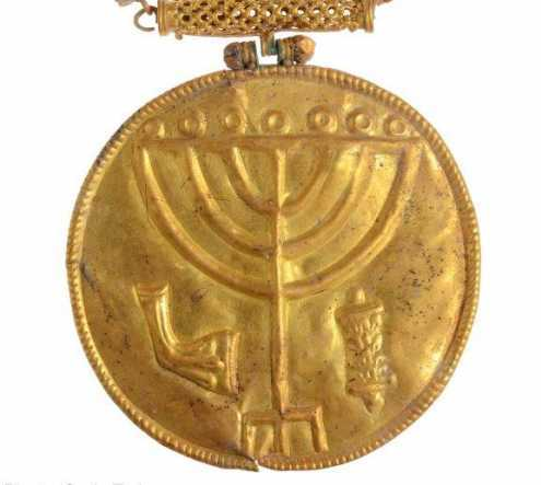 Ancient gold medallion found at foot of Temple Mount in Jerusalem: This 10-cm gold medallion was discovered in Hebrew University excavations at the foot of the Temple Mount in Jerusalem. Etched into the medallion are a menorah (Temple candelabrum), shofar (ram's horn) and Torah scroll. Along with other treasures including thirty-six gold coins and gold and silver jewelry, the medallion was likely abandoned during the Persian conquest of Jerusalem in 614 CE. (Photo by Ouria Tadmor)