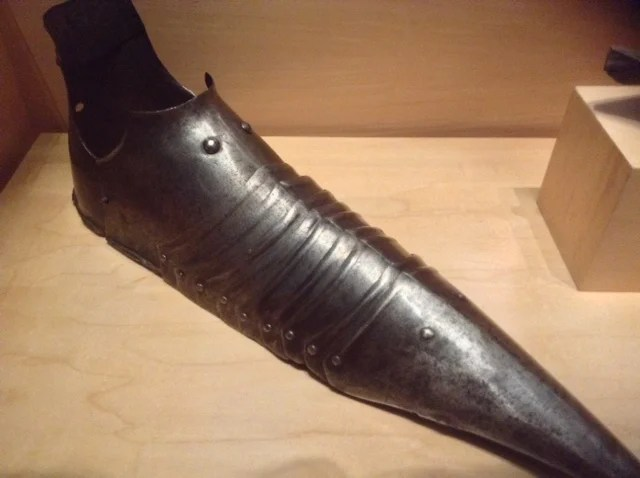 Armoured shoes: This late 15th century metal sabatons were part of a complete suit of armour. The narrow strips of metal would have helped the man secure his foot in a stirrup while riding.