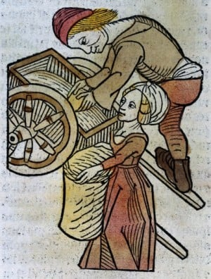 A man and a woman loading a cart, woodcut,1491 -  Credit: Wellcome Library, London