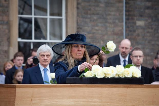Philippa Langley placing a rose on Richard's casket. Will Johnston - Leicester Cathedral.