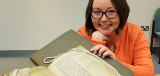 Dr Kylie Murray with the Boethius manucript - photo courtesy the University of Oxford