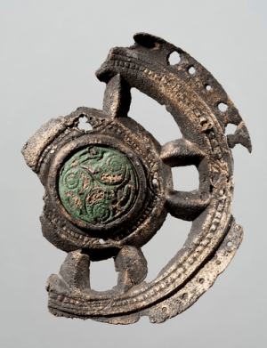 Mounting, probably from a religious object, produced in Ireland in the 8th century. The mounting have traces of modifications and was probably used as a brooch. It was found in a woman's grave from the first part of the 9th century, in Oppland, Norway - Photo courtesy University of Oslo Museum of Cultural History