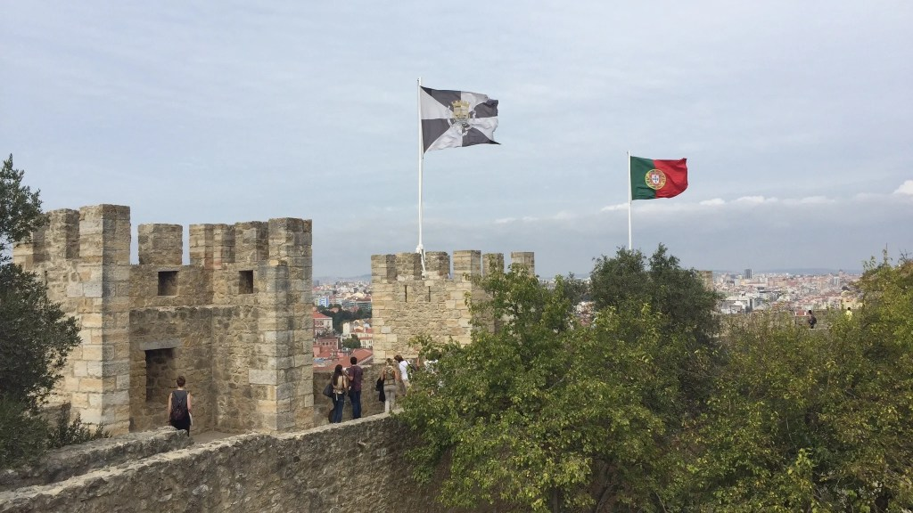 Walking along the castle walls, you can see the red and green flag of Portugal whipping in the wind alongside the black and white flag of the city. Photo by Medievalists.net.