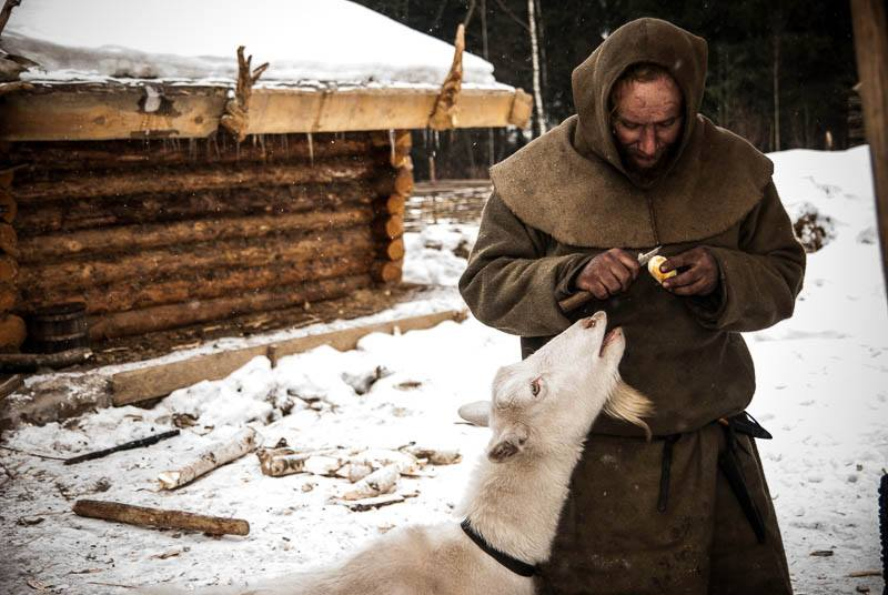Pavel Sapozhnikov and his goat, Glasha, surviving a harsh Russian winter living as people did in the ninth century. Photo courtesy of Alone in the Past.