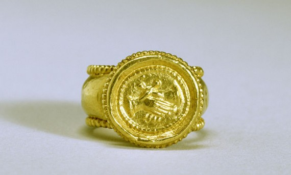 6th century Byzantine marriage ring - The hoop and circular bezel of this gold ring are edged with beads. The motif of the clasped hands, signifying love, betrothal, and marriage, was first introduced in the Roman period and remained a popular symbol until the 19th century. Photo from Walters Art Museum