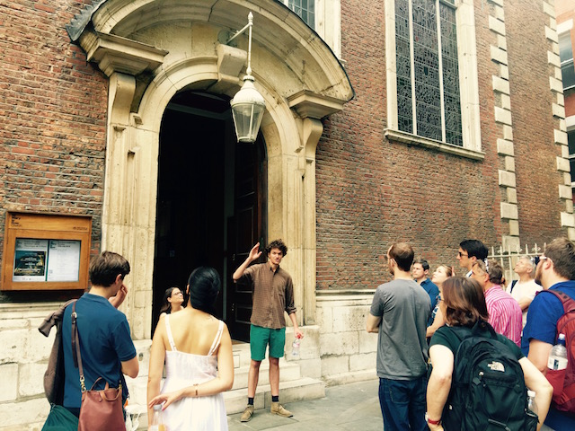 Green talking about life in medieval London in front of St. Mary-le-Bow Church, Cheapside.