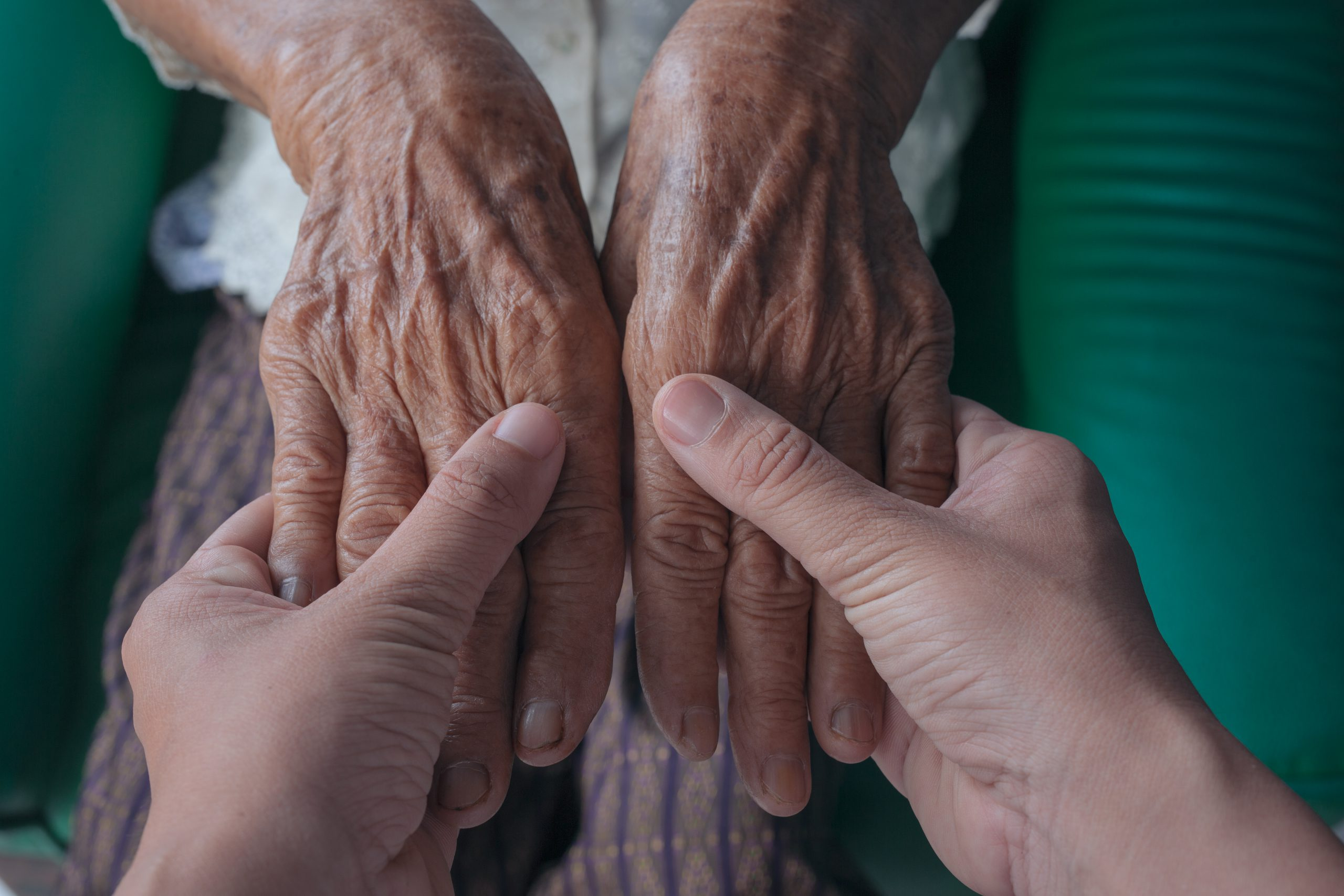 Holdimng patient hands by a Registered Nurse. MEDIjobs