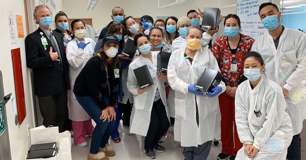 Free stuff For Frontline Medical Workers during COVID-19 - Paderia Bakehouse delivered. Room of doctors and nurses on covid unit holding boxes of cookies with masks on