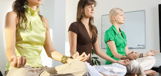 Buinesswomen sitting in lotus position (relaxation; sitting; yoga; exercise; health; meditate; meditation;)