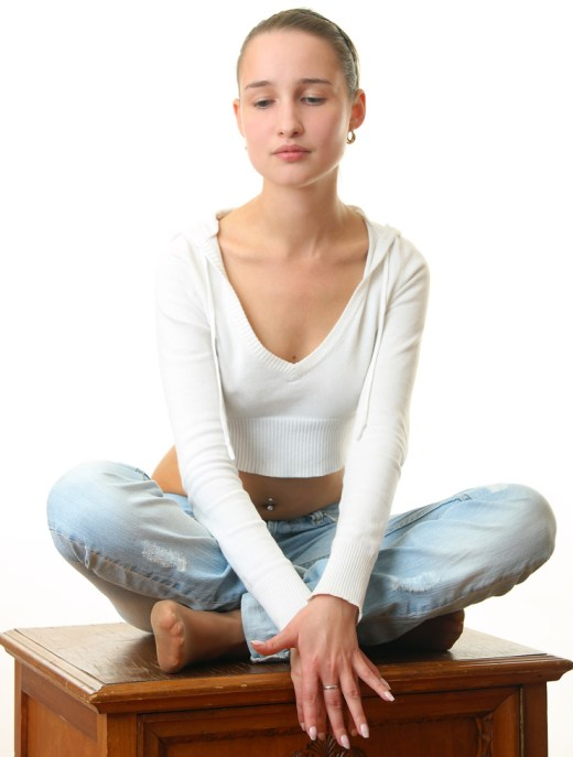 The beautiful girl sitting in a pose of a lotus