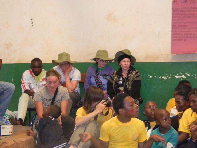 """Photo 7. The United Nations International Day of Persons with Disabilities (December 3rd, 2014) in Pomerini. During the day, mostly people with physical and mental disabilities were present, though in addition three people with albinism were invited to bear witness to their life experiences in Tanzania. During the ceremony, one of them affirmed that """"We as people with albinism claim full recognition in the country.""""   2014 © Giorgio Brocco"""