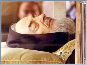 The body of Saint Padre Pio exposed in the crypt in San Giovanni Rotondo where Joshua's father implored the saint to give him new hope
