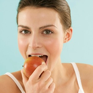 Woman eating an apple --- Image by © RG Images/Stock4B/Corbis