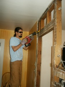 picture of John working on demolishing the kitchen wall