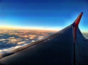 Plane Wing and the Setting Sun