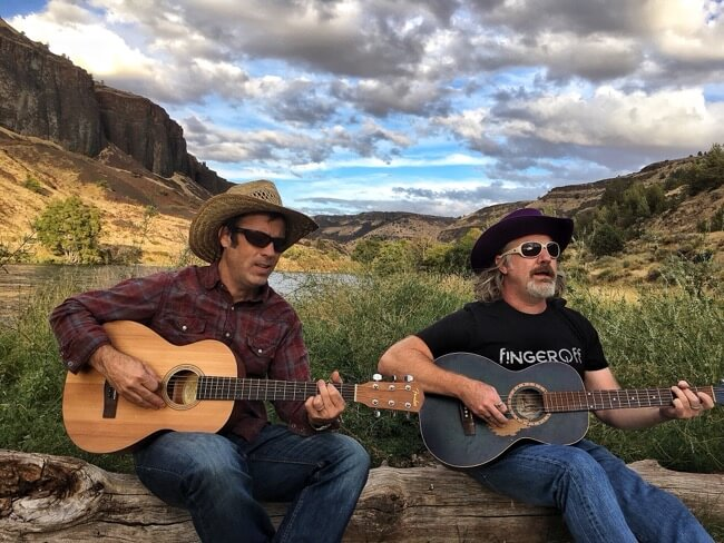 Guitar players on the Deschutes River