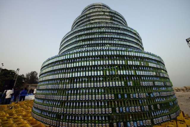 A Christmas tree made of beer bottles stands in Lagos on December 17, 2014. Nigeria's first indigenous beer brand, Star Lager, has completed the building of the world's largest bottle tree made with a total of 8,000 Star Lager bottles. AFP PHOTO / PIUS UTOMI EKPEI