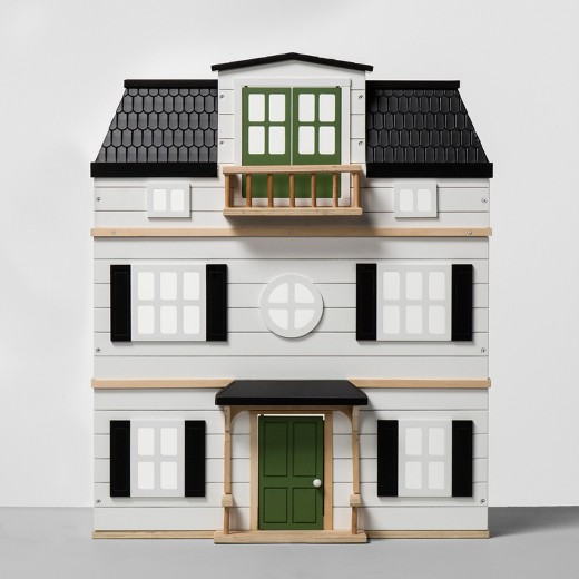 Dollhouses at Target include this white two-story, wooden dollhouse with black shutters and a green door. Made by Hearth & Hand for $129. #dollhouses #magnoliadollhouse #TargetToys