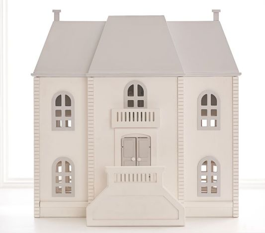 The Barrington Dollhouse from Pottery Barn Kids is expensive at $399 but this mansion features 12 bedrooms, 15 windows, a storage drawer, a balcony and staircase. #PotteryBarnKids #Dollhousesforkids