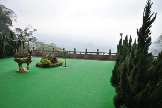 astroturf covers the terrace outside of a monastery