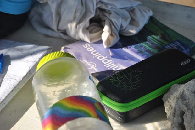 Obligatory photo montage of the usual suspects rolling around Danica's table: Chunk of coral, sunglass cases, guidebook, water, really dirty t shirt (converted to rag).