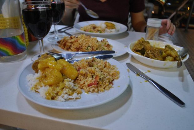 A Macanese dinner outside with Portuguese, Chinese and African influences.
