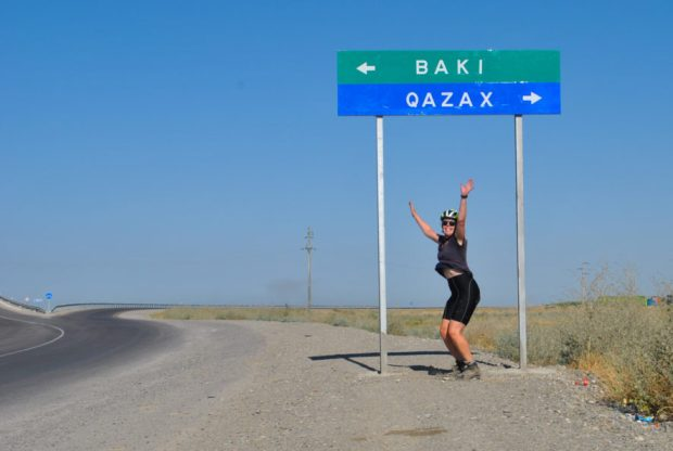 me caught just before I jump in front of a sign for Baku and Qazax in Azerbaijan