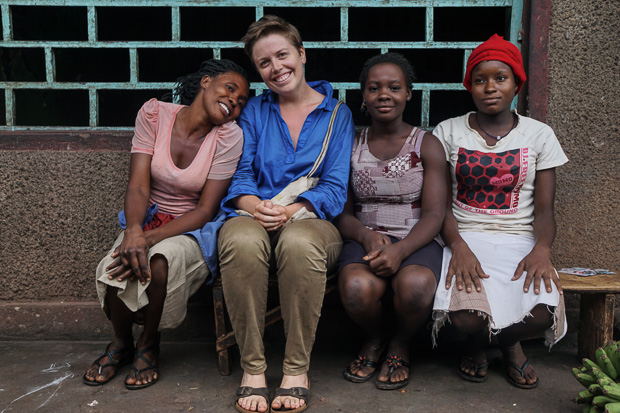 me with three ugandan women in skirts at masindi public market, uganda