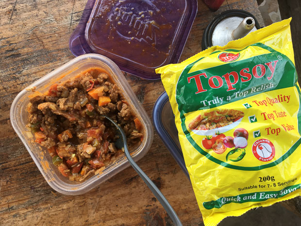 a package of TopSoy soya pieces beside a plastic container of our leftover soya stew