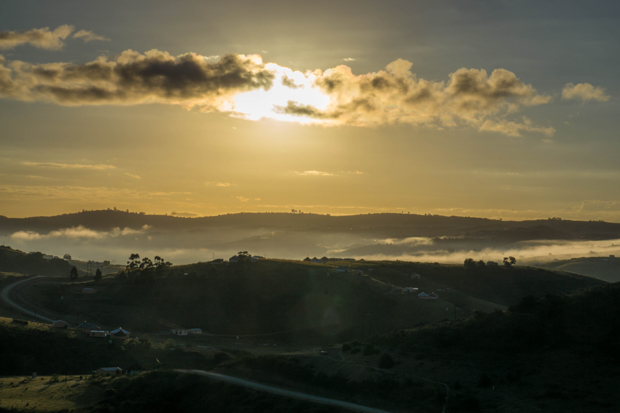 early morning sun over the hills and winding dirt roads in the transkei